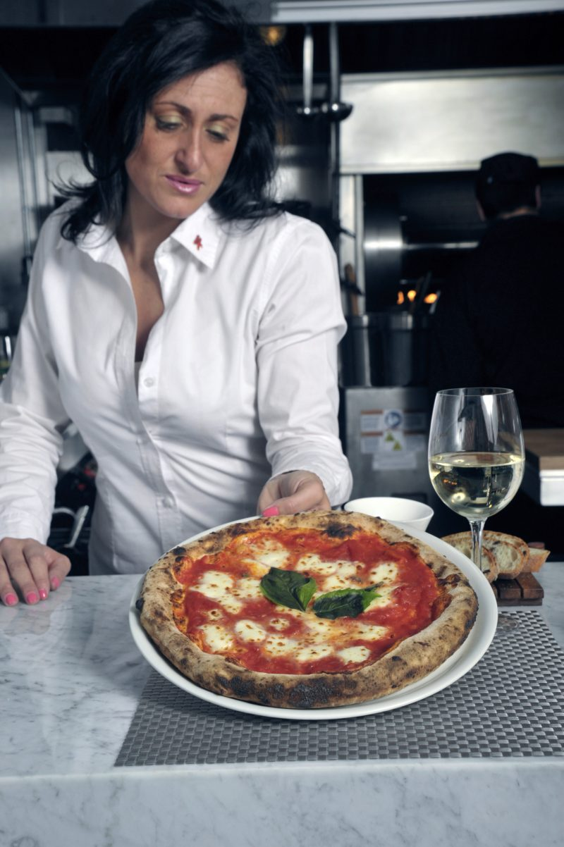 lady holding up pizza