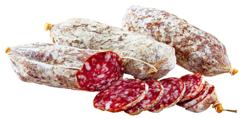 Three rolls and several slices of Italian salami are shown in front of a white background.
